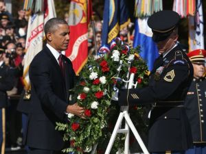 President Barack Obama laying a wreath at the Tom of the Unknown Soldier in Arlington National Cemetery. (Photo by Mark Wilson for Getty Images)